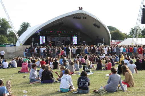 Music-lovers crowd into the sand pit at front of stage